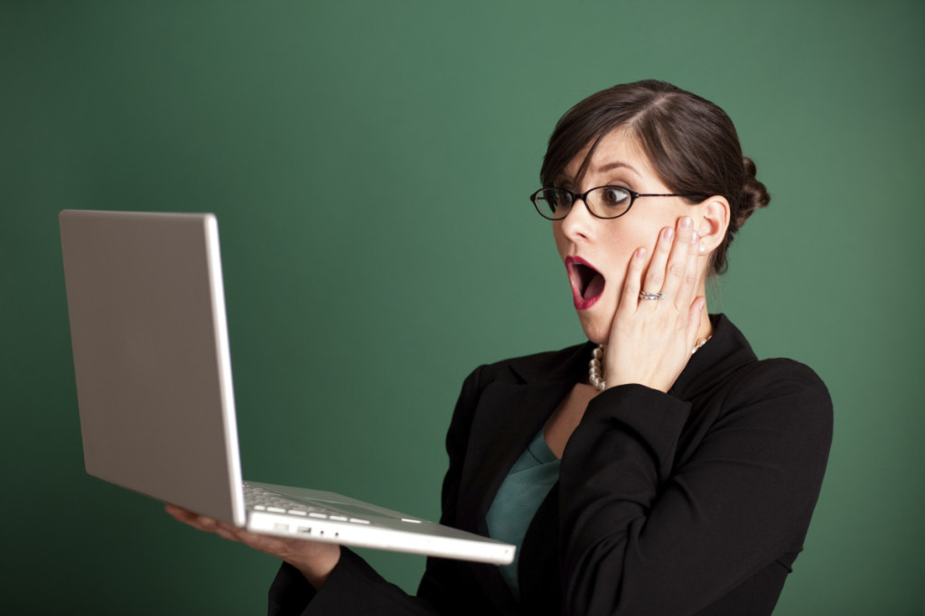 shocked-woman-lawyer-laptop-1024x682