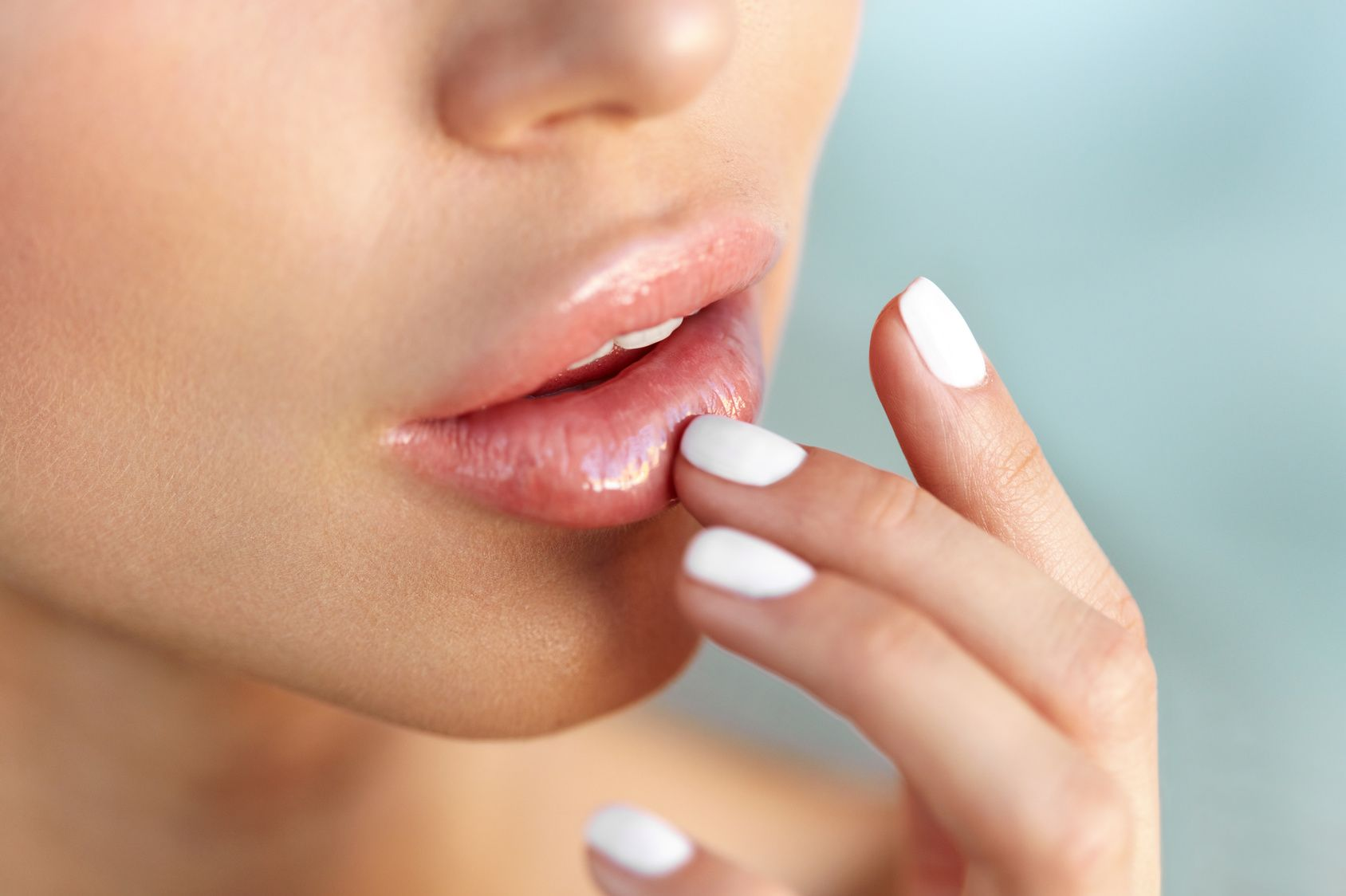 Lips Protection. Closeup of Healthy Woman Lips And Smooth Skin